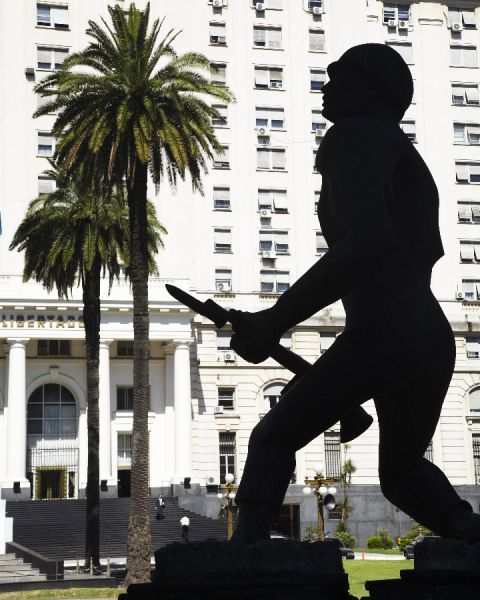 Argentina, Buenos Aires Province, Buenos Aires. Silhouted statue of a soldier outside a military building in Buenos Aires