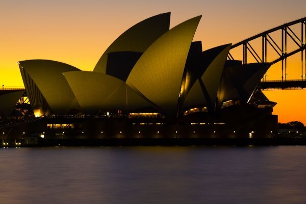 Australia, New South Wales, Sydney. Sydney Harbour bridge and the opera house viewed at sunset