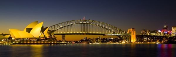 Australia, New South Wales, Sydney. Sydney Harbour bridge and the opera house viewed at dusk