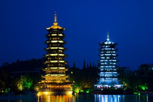 China, Guangxi Zhuang Autonomous Region, Guilin City. Illuminated Pagodas at dusk, located near Banyan Lake in downtown Guilin