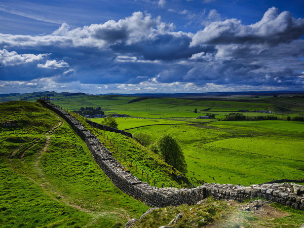England, Northumberland, Northumberland National Park. A well preserved stretch of Hadrian's Wall passing along Caw Gap
