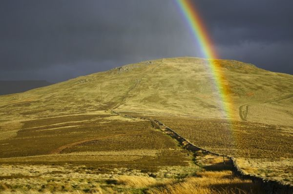 England, Northumberland, The Pennine Way. A rainbow above the Schil on the England