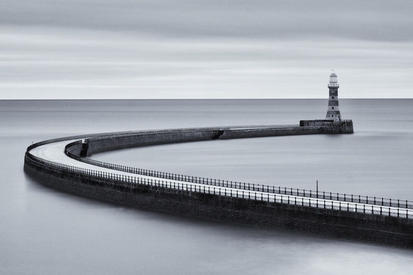 England, Tyne and Wear, Roker Pier. Roker Pier and Lighthouse located at the mouth of the River Wear in the city of Sunderland