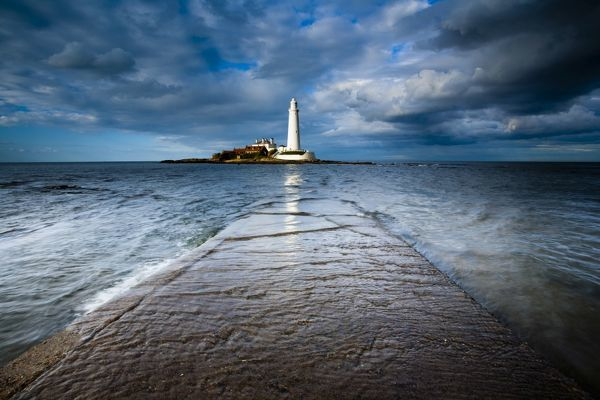 England, Tyne and Wear, Whitley Bay. Incoming tide engulfs the causeway linking St Mary's Island & lifehouse to the mainland