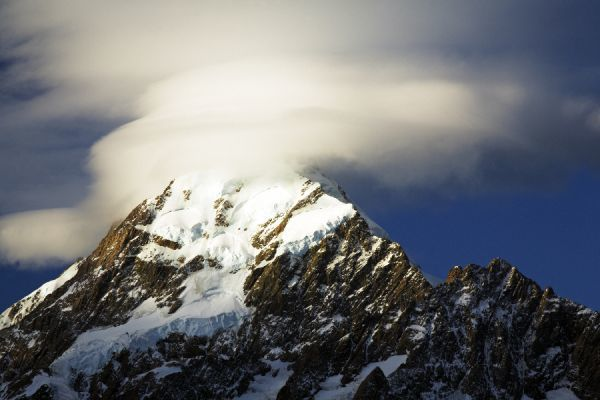 New Zealand, Canterbury, Mt Cook National Park. Storm clouds hug the peak of the mighty Mt Cook (known to the Maori as Aoraki) the highest peak in Australasia at 3755M