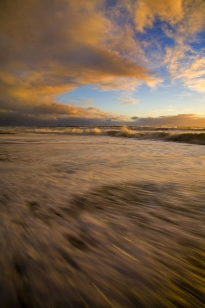 New Zealand, Westland, Hokitika. Sunset on the rugged west coast beach at Hokitika
