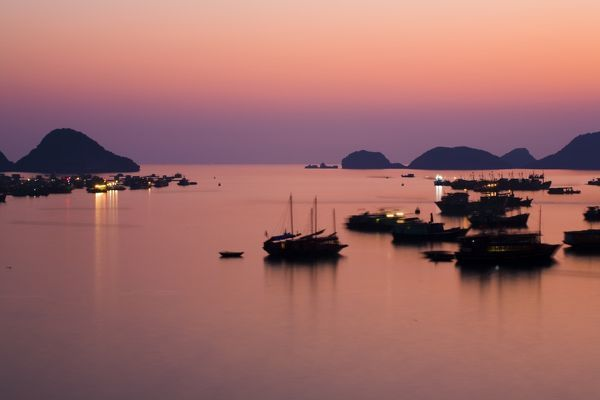 Vietnam, Northern Vietnam, Halong Bay. The pink sunset afterglow at dusk over Cat Ba harbour on Cat Ba Island