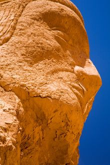 Chile, Atacama Desert, Plaza Quitor. Carved face in the stone wall of the Atacama