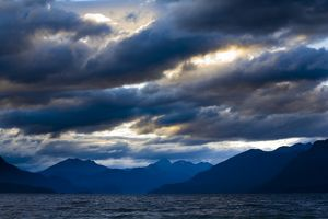 New Zealand, Southland, Fiordland National Park. Dramatic skies over Lake Ta Anau