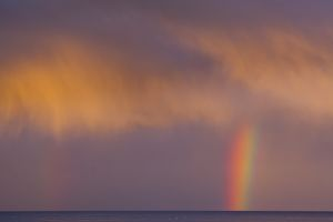 Scotland, Scottish Borders, Burnmouth. Rainbow above the north sea, photographed