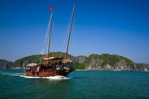 Vietnam, Northern Vietnam, Halong Bay. Tourist boat amid the islands of Halong Bay