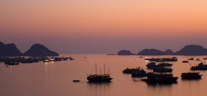 Vietnam, Northern Vietnam, Halong Bay. The pink sunset afterglow at dusk over Cat